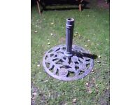 Large heavy decorative cast iron parasol stand.