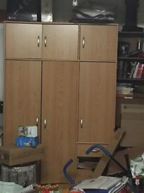 Flat pack wardrobe with a broken base panel.