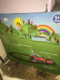 Child's ride on train with 22 piece track