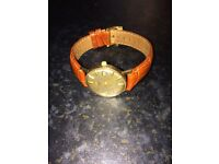 9ct Gold Omega Gents Watch-Automatic. New leather strap, excellent working order. No time wasters.