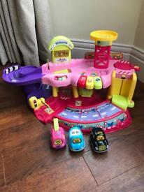 Pink Vtech toot toot garage with 3 vehicles