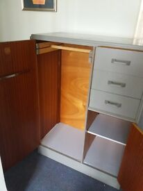 Bedroom unit with hanging space and cupboard space and a drawer the other side