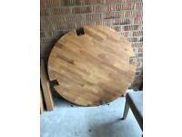 Solid oak dining room table and two chairs