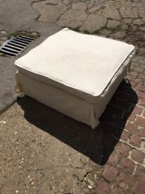 large foot stool with cushion and covers