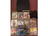 Playstation 3 (slim 160 GB) with 2 controllers and 11 games