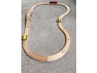 Small wooden train track with train and 3 magnetic carriages