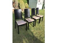 Four black wood chairs with beige padded seats ( can deliver )
