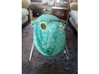 Baby bouncer chair.Turquoise blue with zoo animals on.