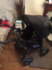 Pram in good condition comes with rain covers and carry cot from birth onwards