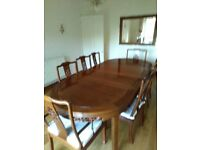 Rosewood 8 seater dining table and chairs