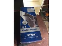 Electric shower triton