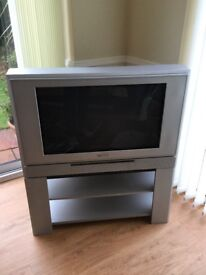 Toshiba TV with matching stand and remote.