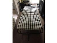 Fold-away single camping bed