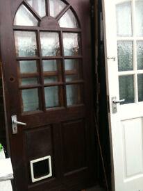 Exterior hardwood door with crazed glass squares and cat flap