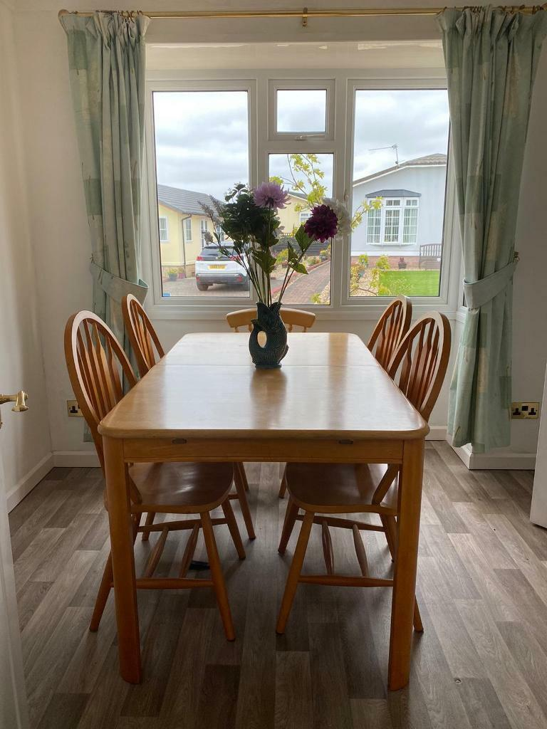 Extending dining table ( 8 seater) and 4 chairs. | in ...