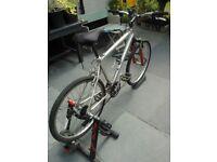 Elite bike trainer.... as good as new.. custom built road bike to go with it!!