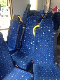 15 Bus seats with seat belts attached