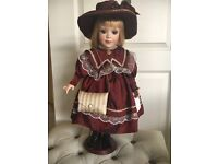"""Vintage porcelain doll 17"""" tall ."""