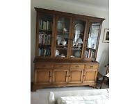 cupboard with book glass fronted case on top