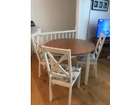 Circular dining table with 3 chairs