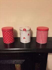 Three tin holders