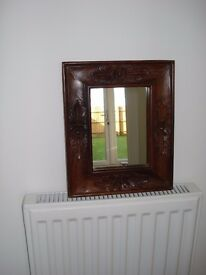Small wall mirror with carved wood frame
