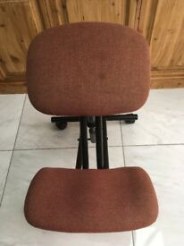 Kneeling Office Chair - Burgundy fabric, steel black frame. Height adjustable for different users.