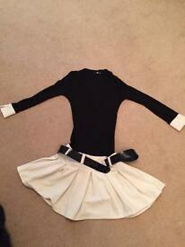 Black dress with cream skirt and cuffs and black belt