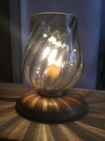 Small bedside type light, glass shade on wooden base.