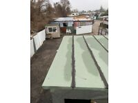 Large Hardstand yard with various workshops or storage units.