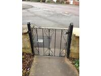Wrought iron gate with posts