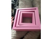 Pink cube shelves