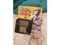 Nintendo 2DS super mario 2 speical edition as good as new in box with pokemon moon.