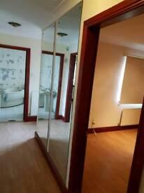 Wall hung frameless mirrors