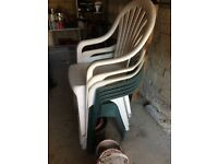 Plastic white and green garden chairs