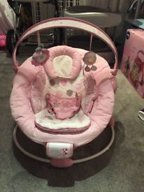 Baby girls pink bouncy chair