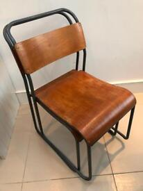 Retro-style industrial stacking chairs
