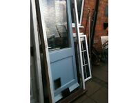 Exterior wooden door with clear single pane glass ,frame and cat flap