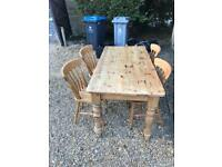 Oak farmhouse table with 4 pine chairs