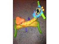 V tech learn and ride giraffe bike