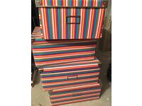 6 multicoloured striped storage boxes