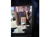 Large brown wooden mirror