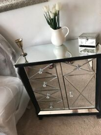 mirrored unit with 5 drawers and cupboard