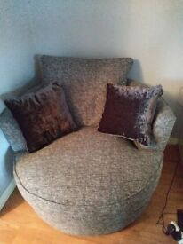 Large grey cuddle chair immaculate condition only new in oct. Smoke and pet free home.