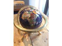 Globe - inlaid with semi-precious stones.