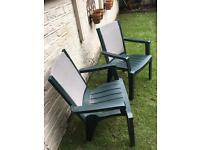 2 green plastic garden chairs