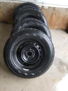 LIKE BRAND NEW  NISSAN ROGUE FIRESTONE PERFORMANCE  WINTER TIRES 215 / 70/ 16 ON OEM RIMS WITH OEM COVERS
