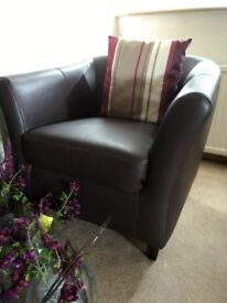 A pair of very comfortable dark brown compact armchairs