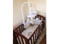 walnut obaby swinging crib with mothercare bedding