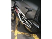 Apollo mountain bike, front and back suspension with 20 inch wheels, 1 year old good condition
